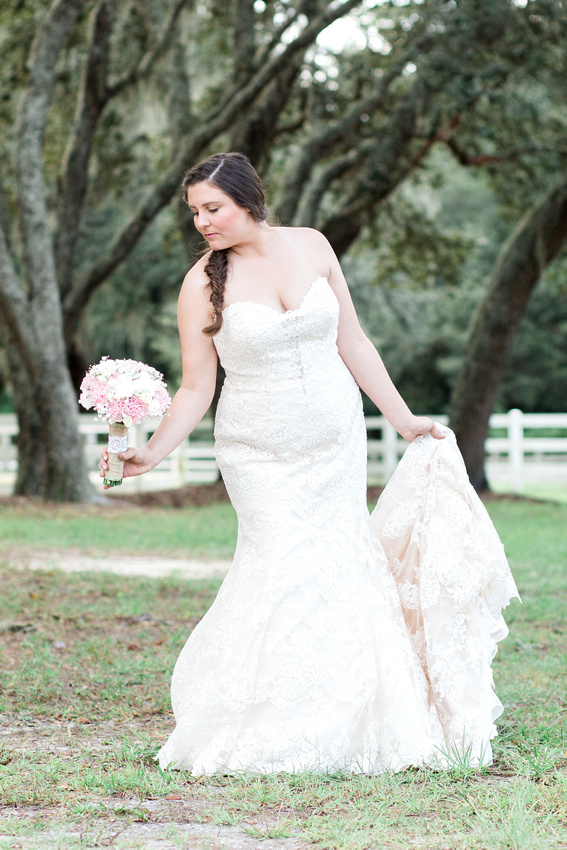 Bridal portraits of bride with horse at Tampa Wedding Venue, The Lange Farm