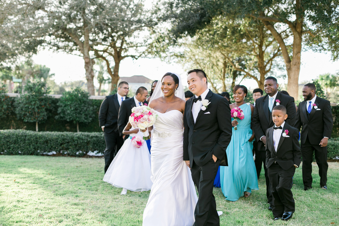 The wedding party posing for photos after an outdoor wedding ceremony at the Palmetto Club at Fishhawk Ranch in Lithia, FL.