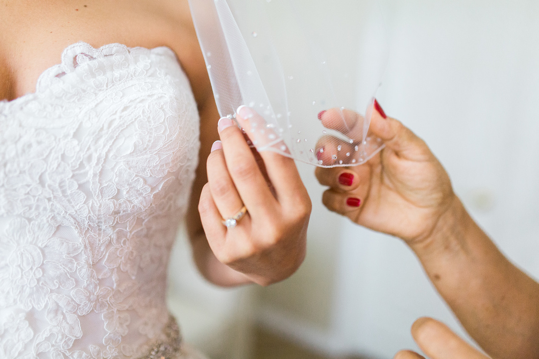 Bride and Groom getting ready on wedding day. Tampa Wedding photographer.