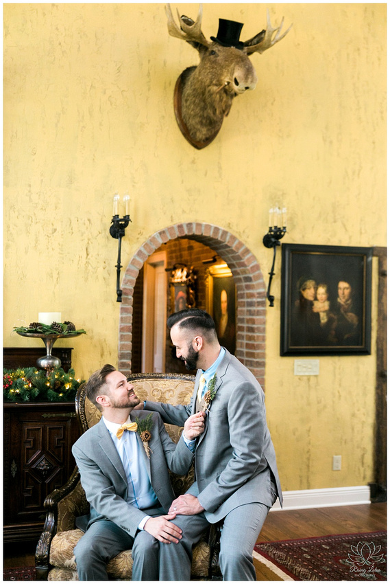 Grooms playfully pose for photos in the game room before their wedding.