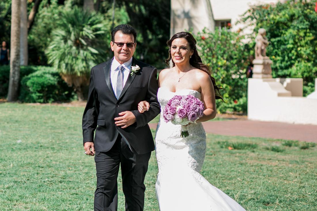 Outdoor wedding ceremony at the Powel Crosley Estate wedding. Tampa wedding photographer.