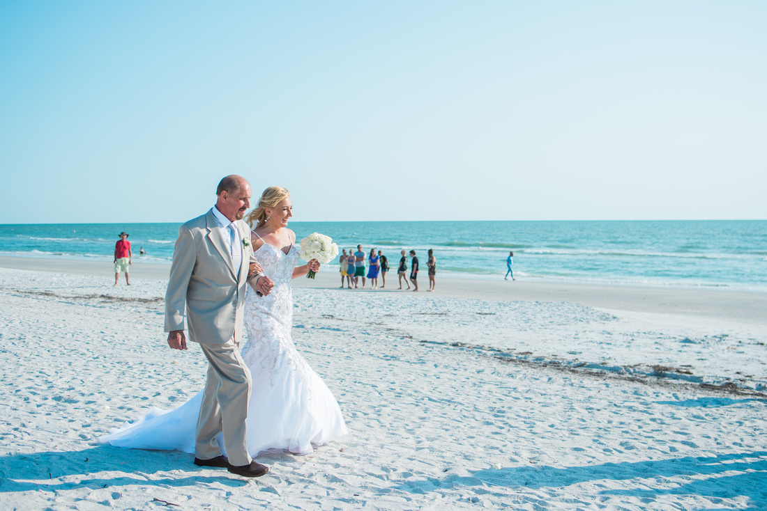 Beach wedding in Tampa, FL. Tampa Wedding Photographer. Destination wedding ceremony.