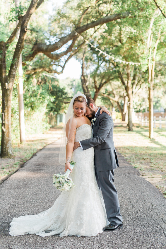Couple's portraits on wedding day. Newlyweds photographed by Rising Lotus Photography in Tampa.
