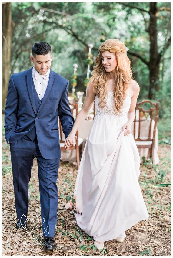 Bride and groom take a walk through the woods at Casa Lantana.