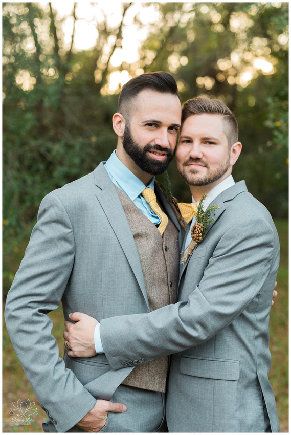 Same sex newlyweds pose for portraits after their ceremony.