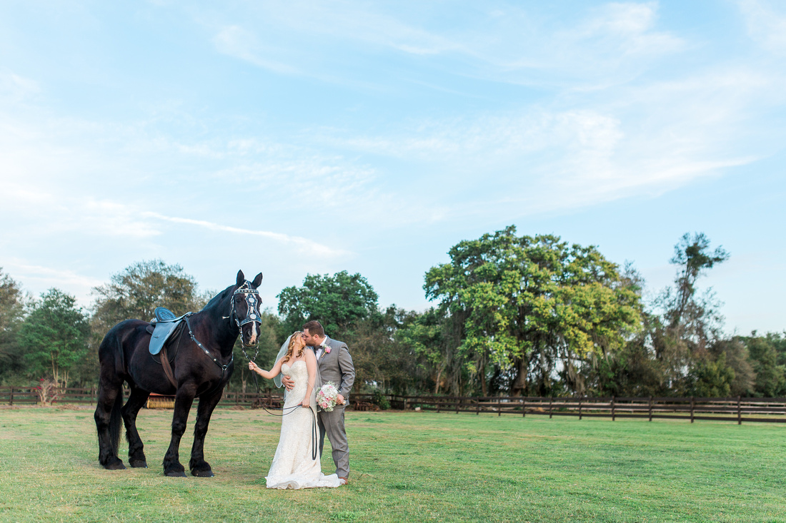 Newlywed photos. Rustic, chic pink wedding at Wishing Well Barn.