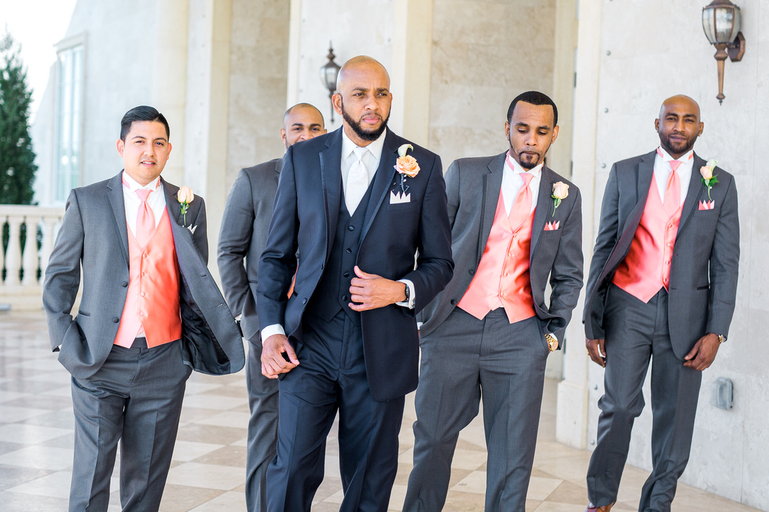 Wedding party photos at The Regent in Tampa. Coral, orange and pink spring wedding
