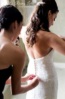 Love this moment of the bride getting into her dress for the first time.