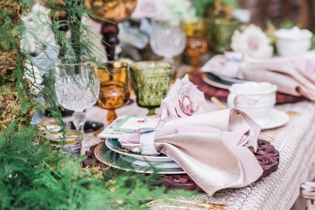 This tablescape with vintage glassware with an earthy color scheme was featured on Ruffled Blog.