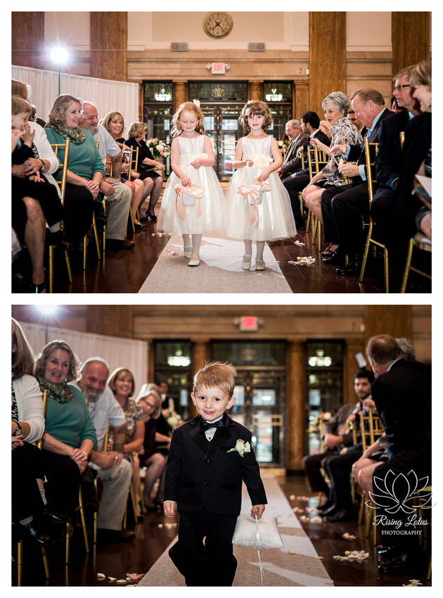 Cute flower girls and ring bearer walk up the aisle during wedding at 90 State Events.