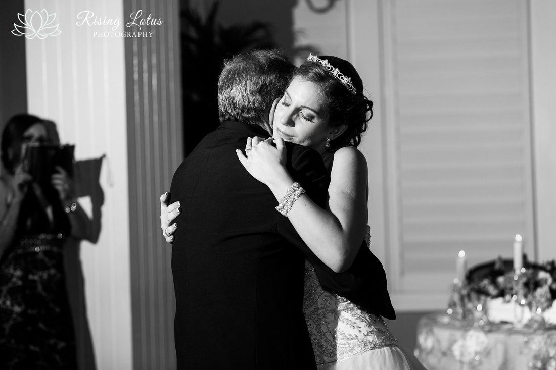 Father and daughter hug during the parent dance
