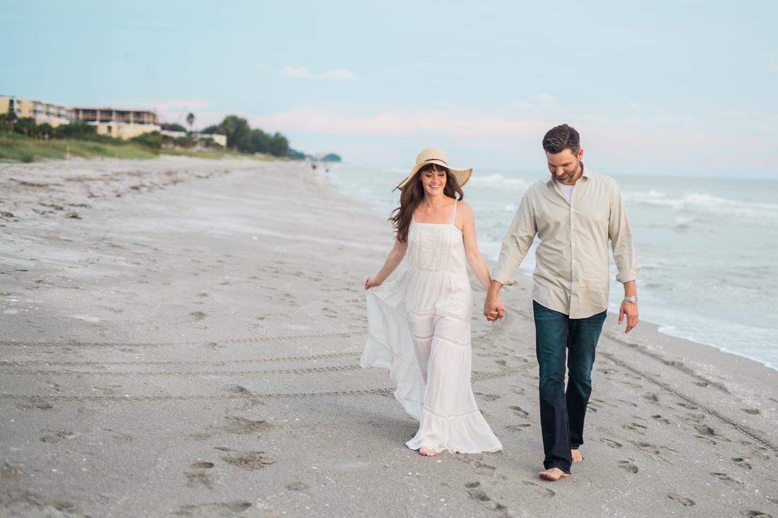 Emily and Chris walk along Longboat Key beach.