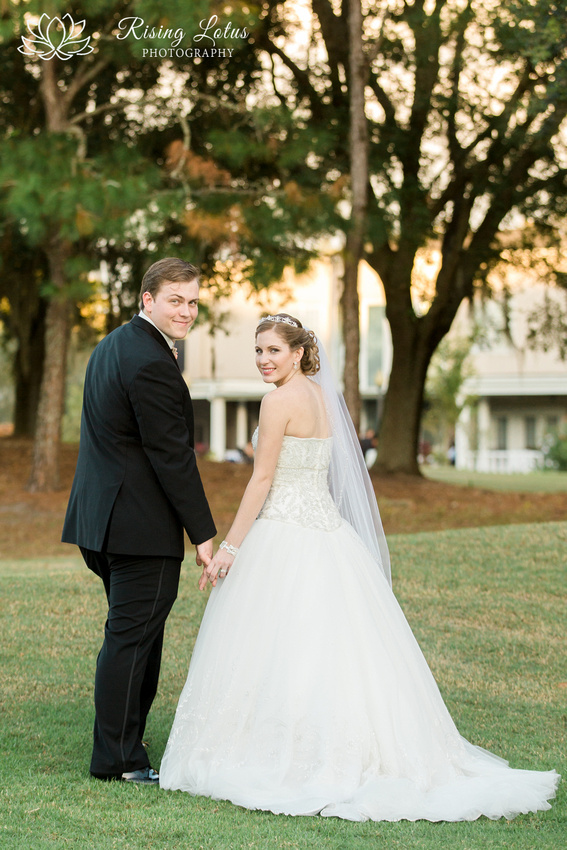 Newlyweds  stand on the golf course at the Wentworth club.