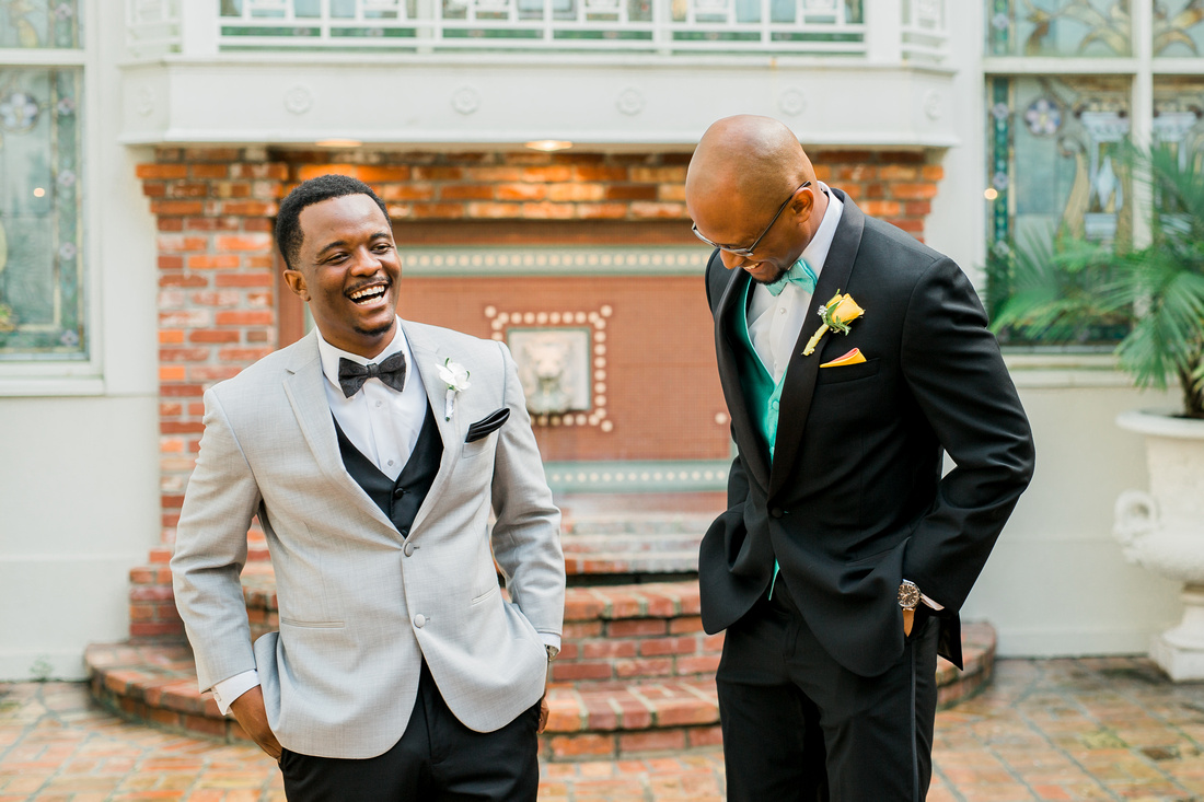 Groom shares a laugh with his best man before his wedding at the Orchid Garden, FL.