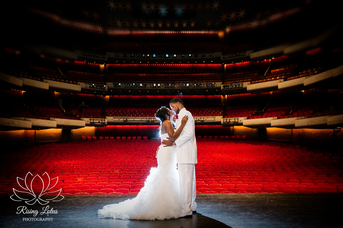 Newlyweds enjoying a few moments alone on stage at the Straz Center in Tampa, FL.