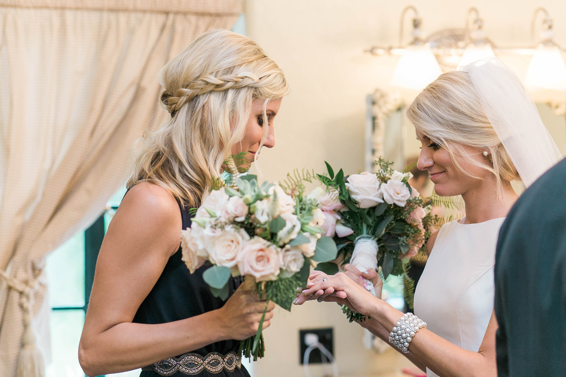 A beautiful moment between a bride and her twin sister minutes after her wedding at the Powel Crosley Estate.