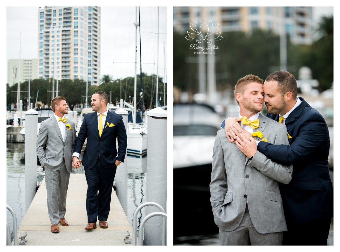 Same sex couple pose for pictures along the St. Petersburg marina before their wedding ceremony about the Starship Yacht