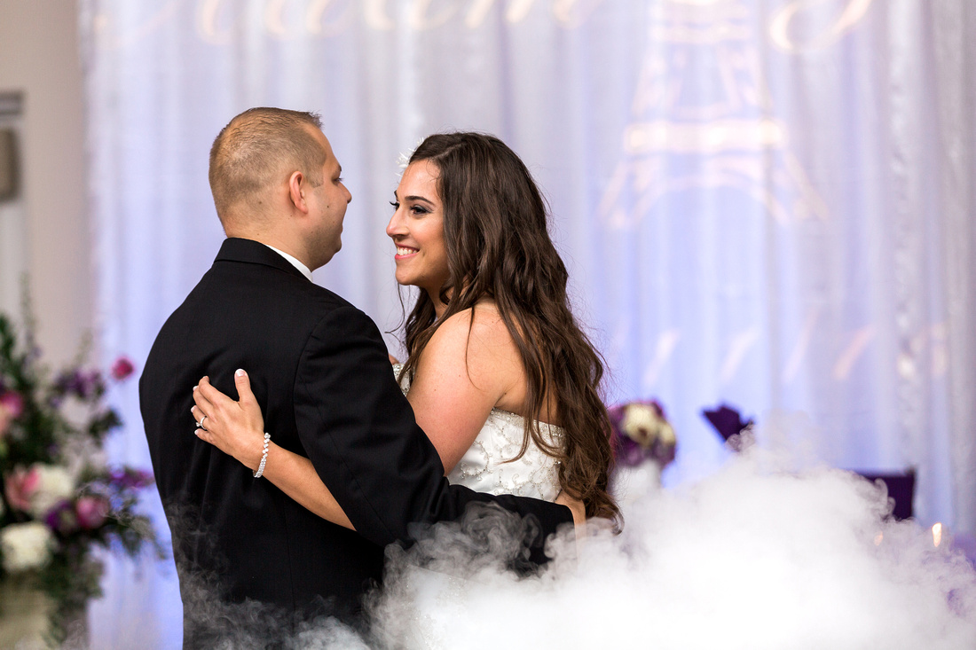 Jaclyn and Adam's first dance was on a fog filled dance floor at the Royal Crest Room.
