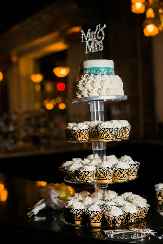 A cupcake tower topped by wedding cake at the Orchid Garden in Orlando.