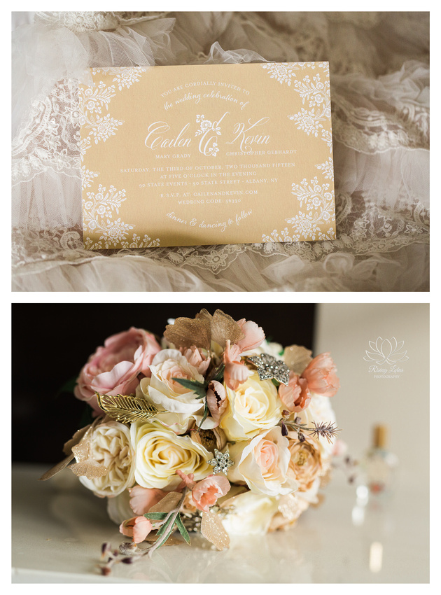 The bridal charm bouquet and the wedding invitation laid out on the bride's gown.