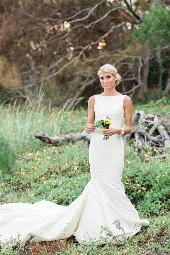 Bride standing field of wildflowers at Fort De Soto.