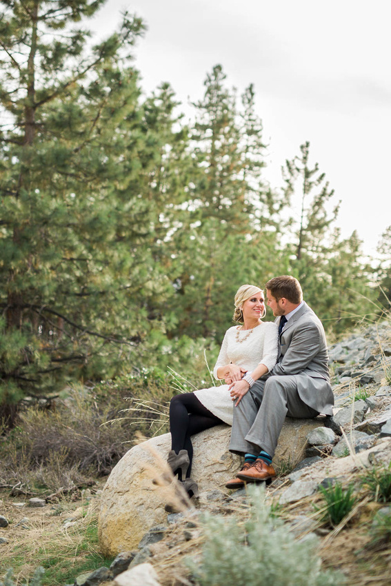 Engaged couple pose for photos during their engagement session in a Lake Tahoe park.
