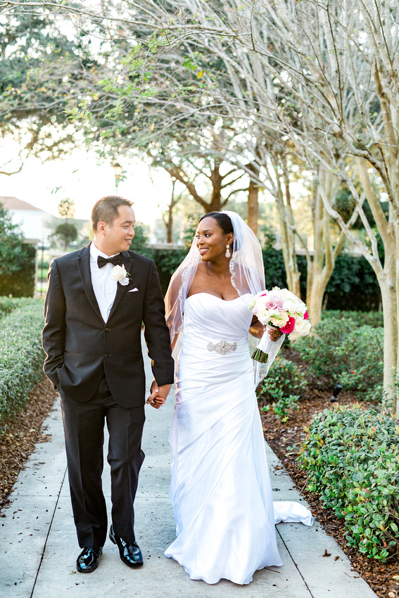 Newlyweds walk to the wedding reception at the Palmetto Club at Fishhawk Ranch in Lithia, FL.
