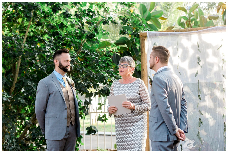 The grooms exchange their wedding vows at the family compound in Tampa, FL
