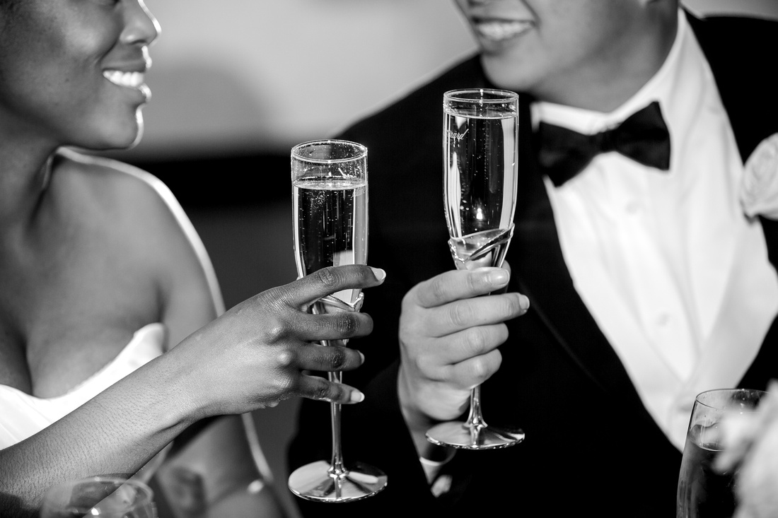 Newlyweds share a champagne toast at a Palmetto Club wedding reception in Lithia, Florida.