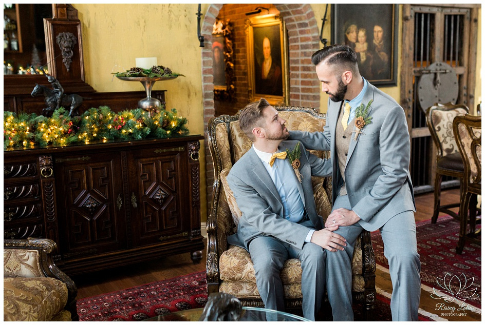 Grooms share a quiet moment in the game room before their wedding in Tampa, FL.
