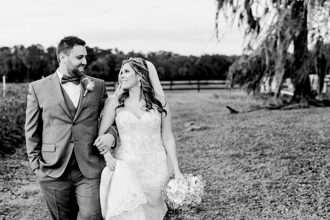 Newlywed photos. Rustic, chic pink wedding at Wishing Well Barn.