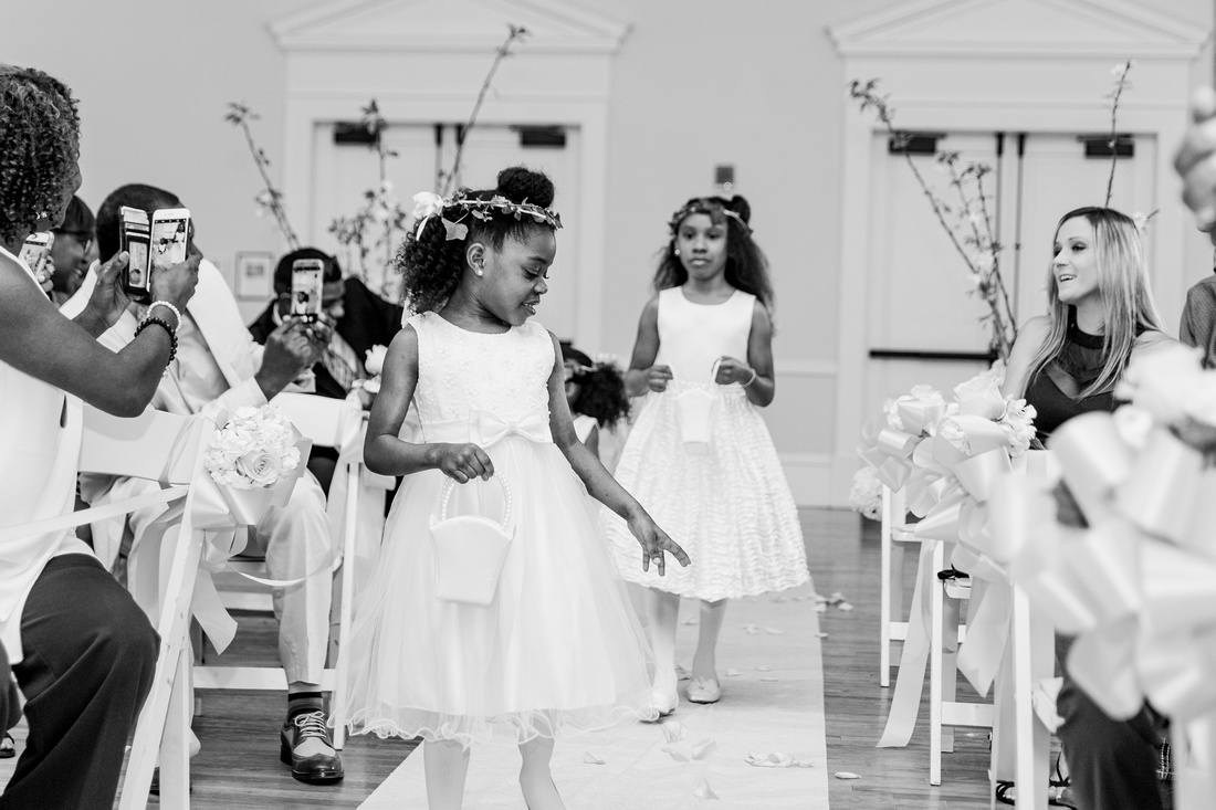 Indoor wedding ceremony with colorful spring hues of coral and pink at The Regent, Tampa Wedding Venue