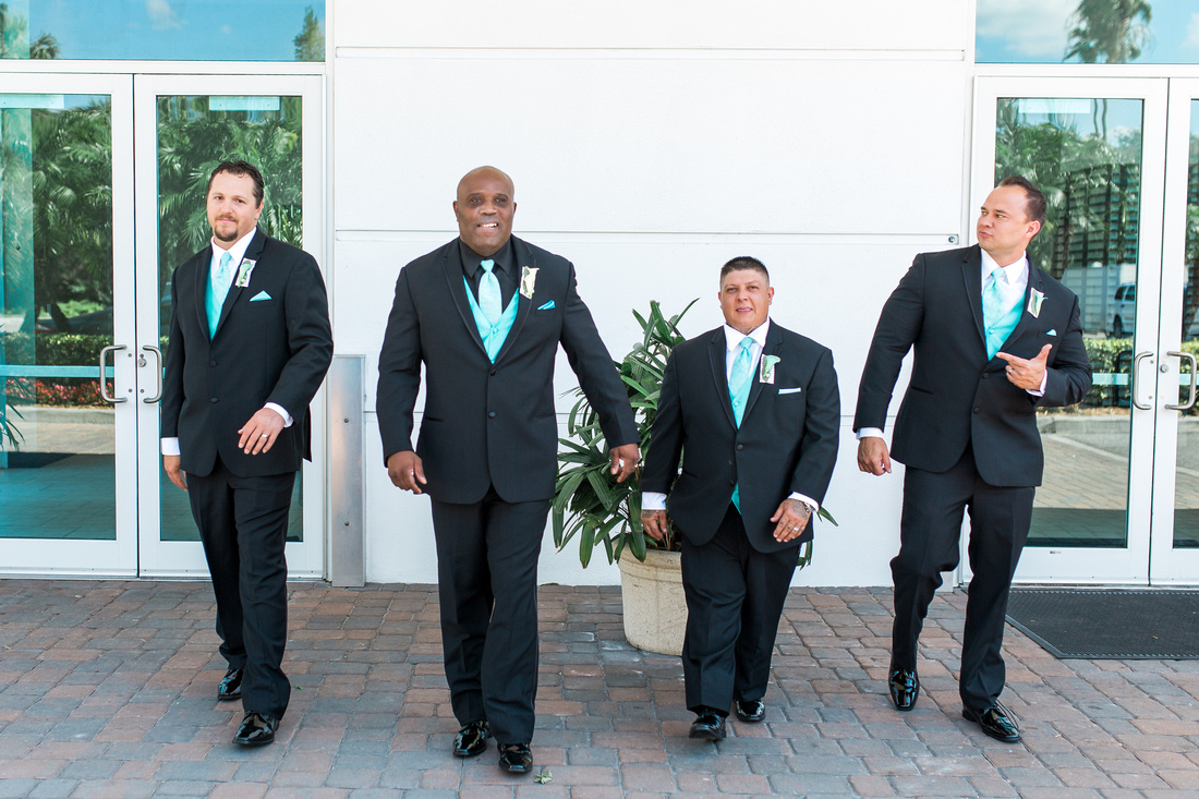 Tiffany blue and white bridal party attire. Bridesmaids and Groomsmen formal portraits.