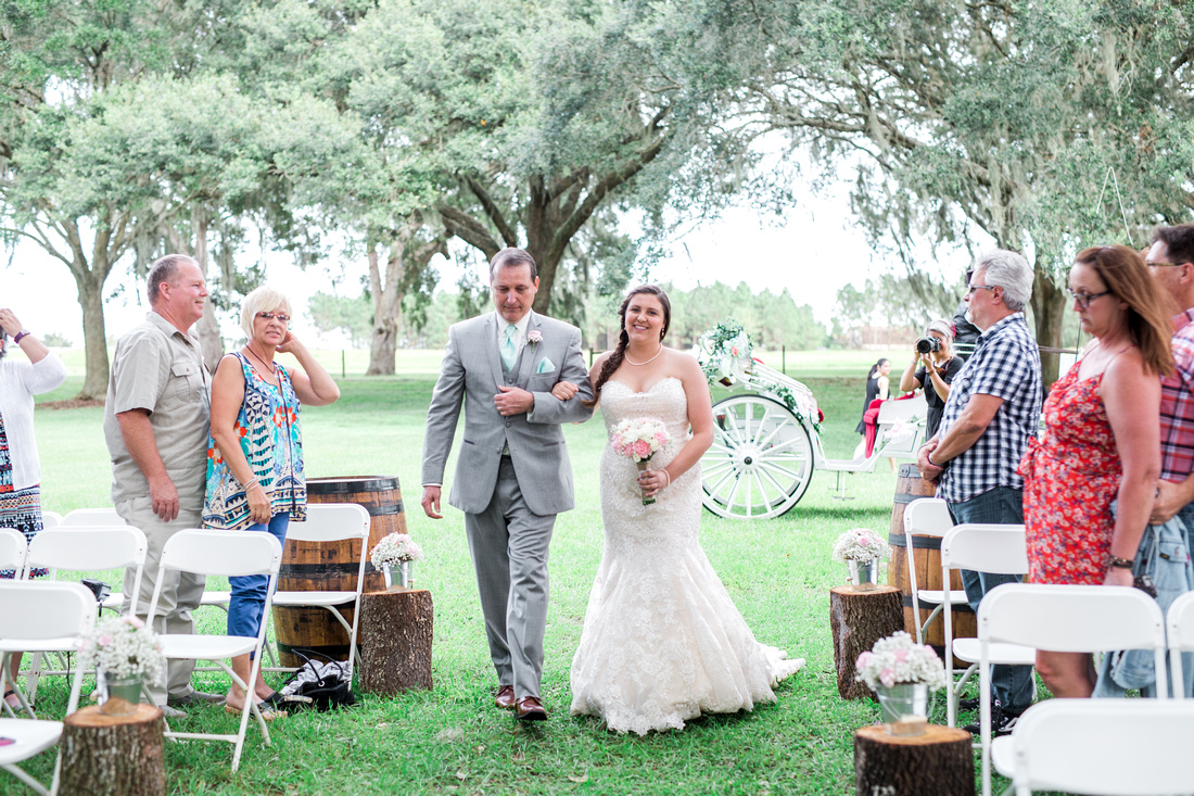 Rustic outdoor wedding ceremony at The Lange Farm in Tampa.
