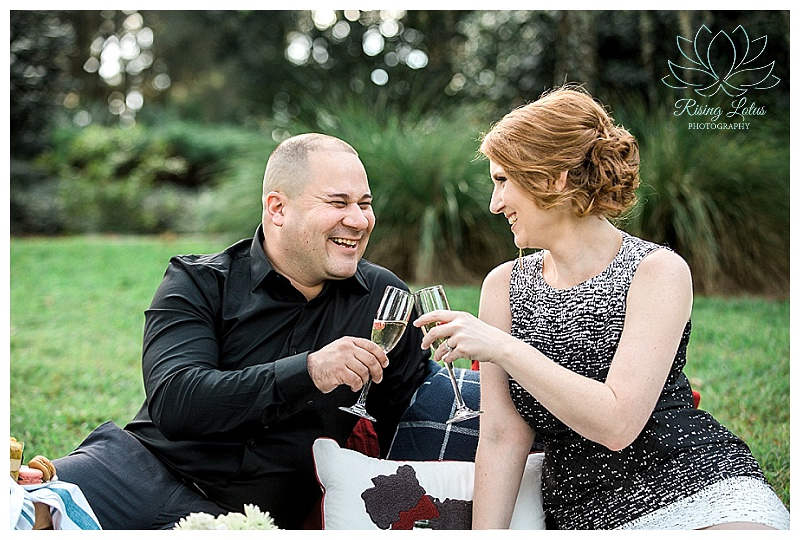 Couple celebrate with a champagne toast during their Bok Tower engagement session.