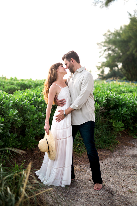 Emily and Chris get close during their romantic engagement session on Longboat Key beach.