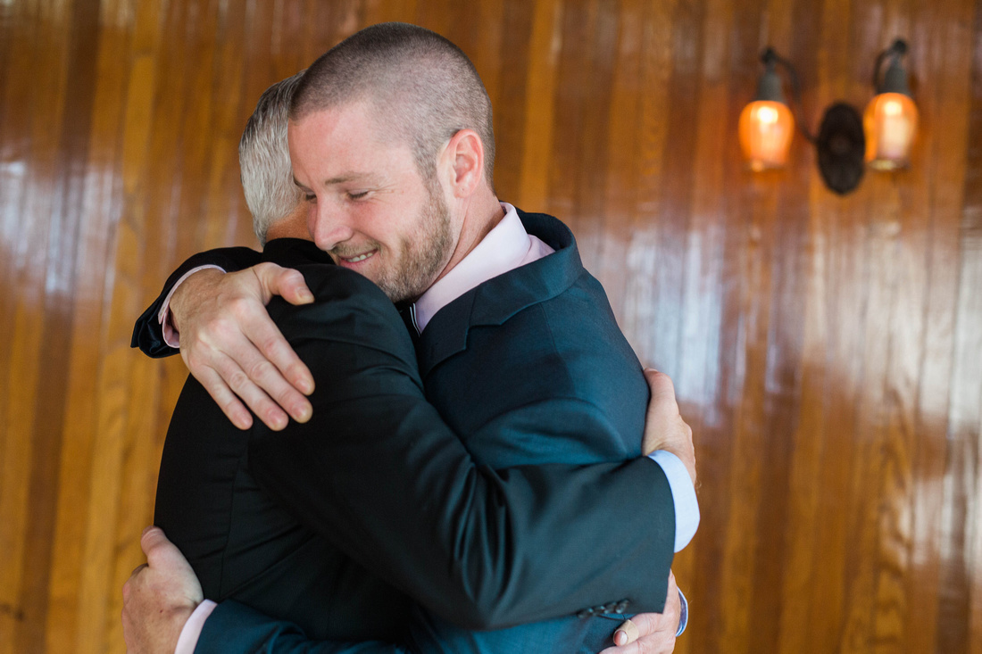 Dom gets a big hug from his dad prior to his wedding at the Powel Crosley Estate.