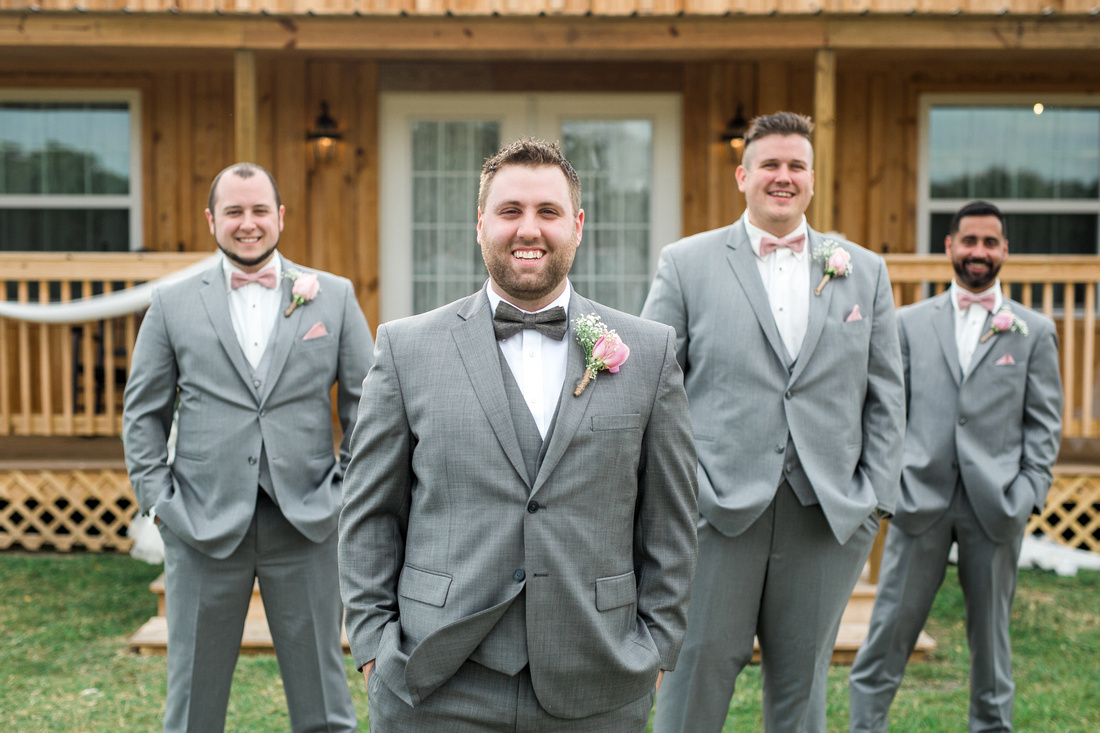 Wedding party images at Wishing Well Barn. Blush bridemaids dresses and  grey suites.
