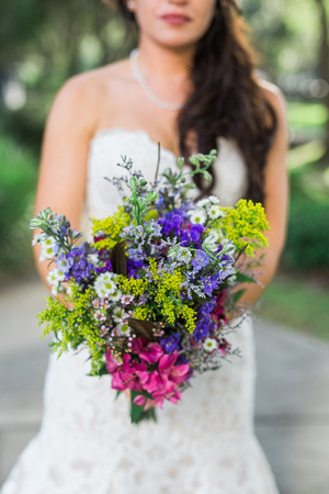 Tampa Wedding Photographer, Rising Lotus, captures DIY wedding details of bride and groom. Wildflower bouquets, lace wedding dress. Church wedding.