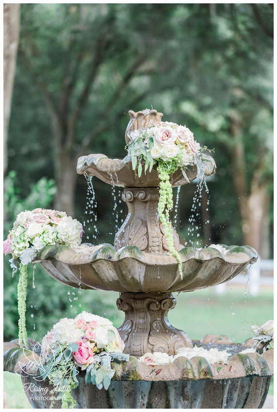 A fountain decorated with flowers at Casa Lantana In Brandon, Florida.