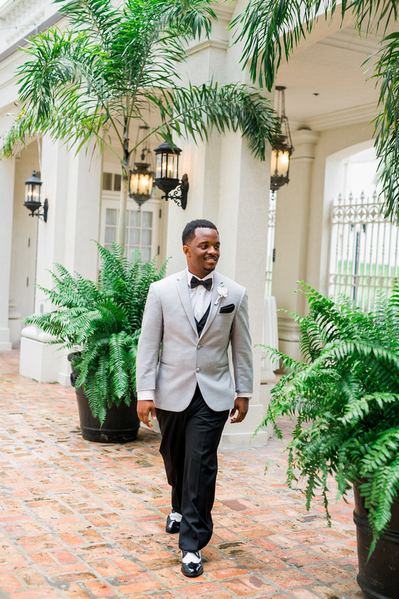 Stylishly dressed groom before his wedding at the Orchid Garden in Orlando, FL.
